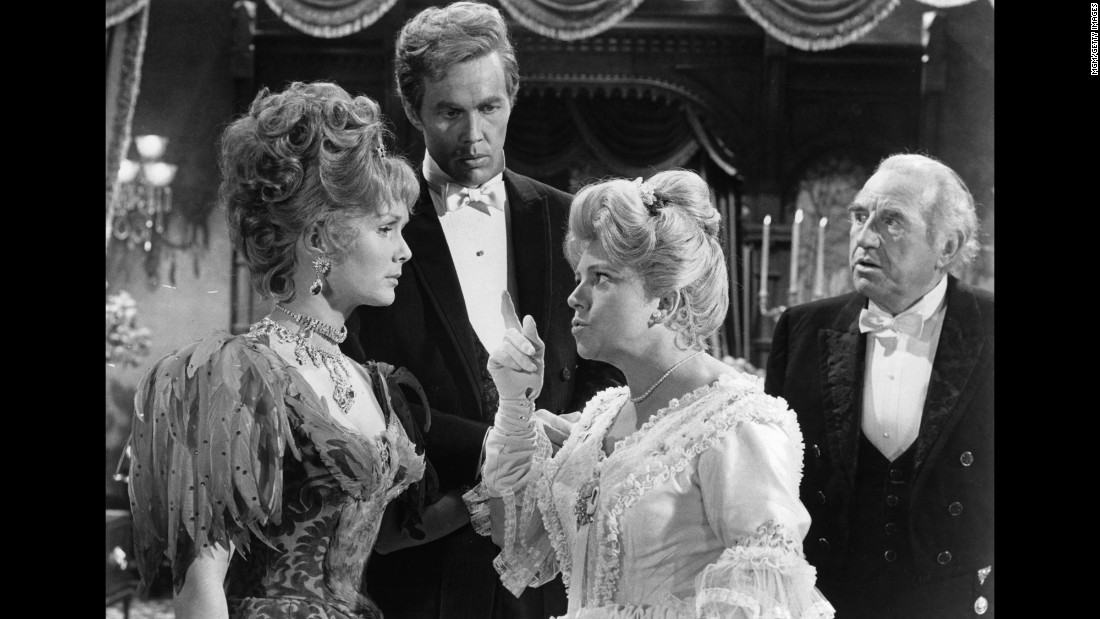 "Hermione Baddeley points her finger at  Reynolds as Harve Presnell and Ed Begley watch during a scene from the 1964 film ""The Unsinkable Molly Brown.""  Reynolds was nominated for an Academy Award for Best Actress for the role."
