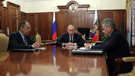 Russian President Vladimir Putin, center, speaks with Foreign Minister Sergey Lavrov, left, and Defence Minister Sergei Shoigu in Moscow on Thursday.