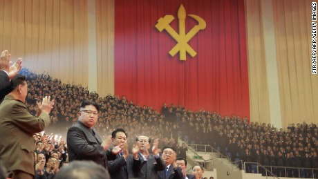This photo taken on December 28, 2016 and released on December 29, 2016 by North Korea's official Korean Central News Agency shows North Korean leader Kim Jong-Un at a joint art performance by the Moranbong Band and the State Merited Chorus in honor of the participants in the First Conference of Chairpersons of the Primary Committees of the Workers' Party of Korea in Pyongyang.
