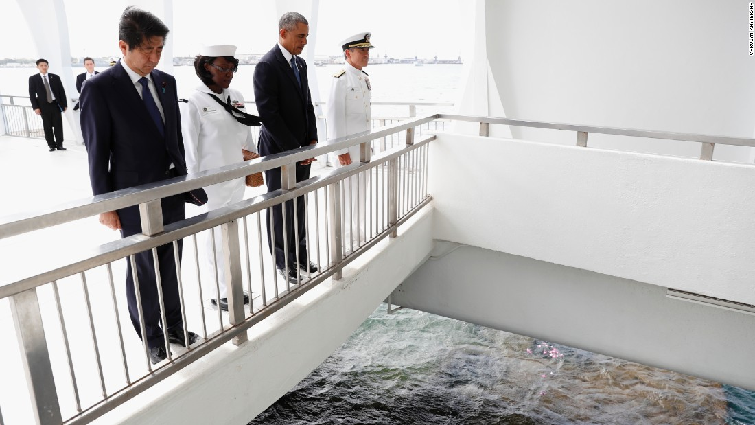 "President Barack Obama and Japanese Prime Minister Shinzo Abe pause after tossing flower petals into the Wishing Well at the USS Arizona Memorial in Joint Base Pearl Harbor-Hickam, Hawaii on Tuesday, December 27. It was part of a <a href=""http://www.cnn.com/2016/12/27/politics/shinzo-abe-pearl-harbor-obama/index.html"" target=""_blank"">ceremony to honor those killed</a> in the Japanese attack on Pearl Harbor 75 years ago."