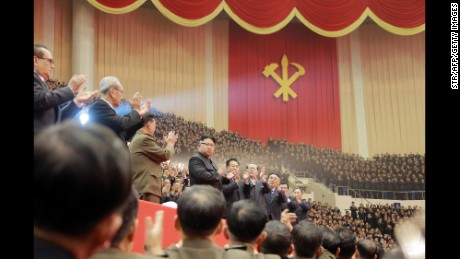 TOPSHOT - This photo taken on December 28, 2016 and released on December 29, 2016 by North Korea's official Korean Central News Agency (KCNA) shows North Korean leader Kim Jong-Un (centre L) at a joint art performance by the Moranbong Band and the State Merited Chorus in honor of the participants in the First Conference of Chairpersons of the Primary Committees of the Workers' Party of Korea in Pyongyang. / AFP / KCNA via KNS / STR        (Photo credit should read STR/AFP/Getty Images)