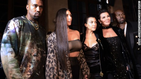 (From L) Kanye West, Kim Kardashian, Kourtney Kardashian, Kris Jenner and Corey Gamble attend the Off-white 2017 Spring/Summer ready-to-wear collection fashion show, on September 29, 2016 in Paris. / AFP / ALAIN JOCARD        (Photo credit should read ALAIN JOCARD/AFP/Getty Images)