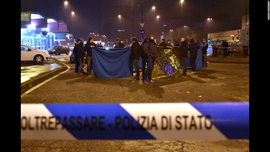 "Italian police cordon off an area after a shootout between police and a man near a train station in Milan's Sesto San Giovanni neighborhood early on Friday, December 23. Italy's interior minister Marco Minniti said the man killed in the shootout is ""without a shadow of doubt"" the<a href=""http://www.cnn.com/2016/12/22/europe/anis-amri-berlin-christmas-market/index.html"" target=""_blank""> suspected Berlin Christmas market attacker, Anis Amri</a>."