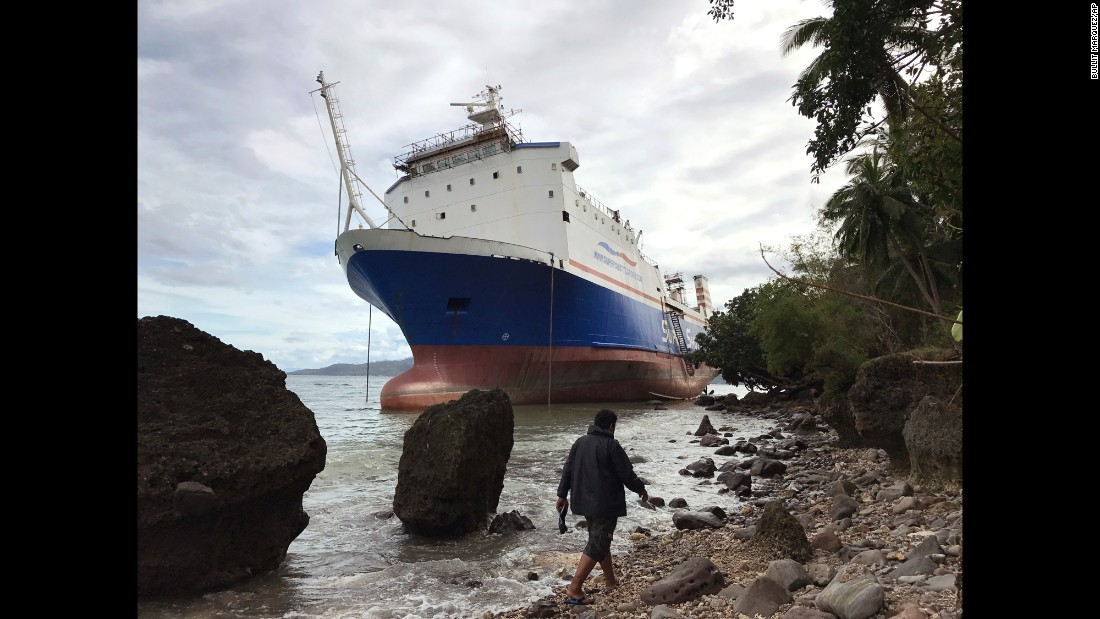 "A cargo ship, M/V Shuttle RORO 5 drifts near the shore south of Manila, Philippines after <a href=""http://www.cnn.com/2016/12/25/asia/typhoon-nock-ten-nina-philippines/"" target=""_blank"">Typhoon Nock-Ten roared</a> over this congested region on Monday, December 26. The typhoon has left more than 11,000 passengers stranded and forced the closure of ports in the Southeast Asian country. <br />"