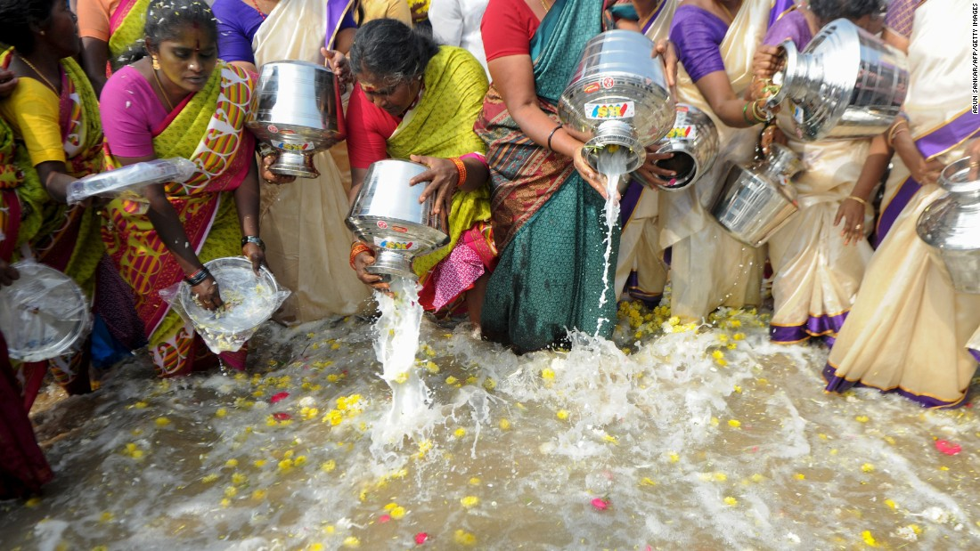 "Indian women pour milk into the sea as an offering during a ceremony for the victims of the <a href=""http://www.cnn.com/2013/08/23/world/tsunami-of-2004-fast-facts/"" target=""_blank"">2004 tsunami at Marina Beach in Chennai</a> on Monday, December 26. The earthquake and tsunami that struck the Indian Ocean on December 26, 2004 killed over 200,000 people and devastated coastal communities. <br />"