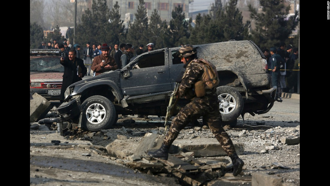 Afghan security personnel inspect the site of roadside bomb blast in Kabul, Afghanistan on Wednesday, December 28.