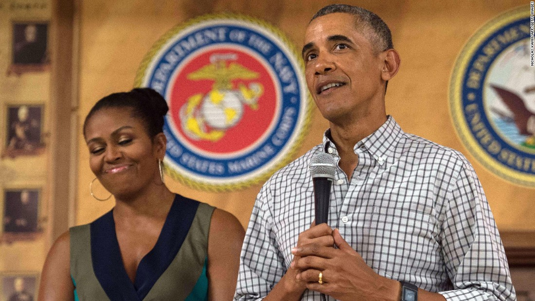 President Barack Obama addresses troops with first lady Michelle Obama at Marine Corps Base Hawaii in Kailua on Sunday, December 25.