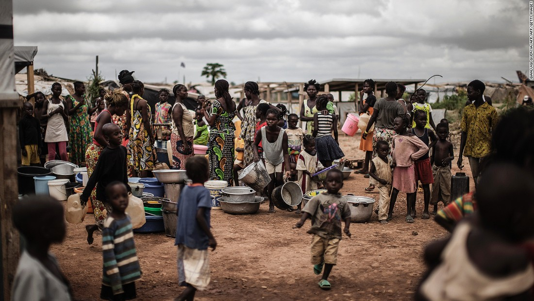 Life inside the camp can be hard with many having lost their jobs or livelihoods. Pictured: People waiting for daily water distribution at a camp in Bangui, Central African Republic, in November 2015.