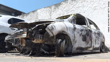 AFP video shows the burned-out rental car of missing Greek ambassador to Brazil Kyriakos Amiridis at a parking lot outside a police station.