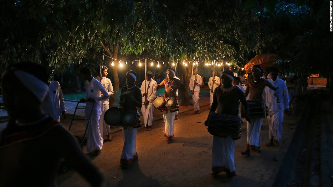 Sri Lankan Buddhist devotees carry various offerings at a temple on New Year's Eve in Colombo, Sri Lanka.