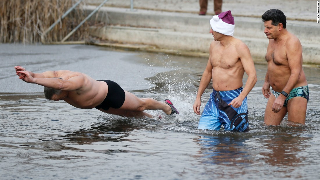 Swimmers plunge into the cold water for the traditional New Year's Eve swim in Moossee, a lake in Moosseedorf, Switzerland.