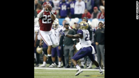 Alabama linebacker Ryan Anderson would score after picking off this pass intended for Washington running back Lavon Coleman.
