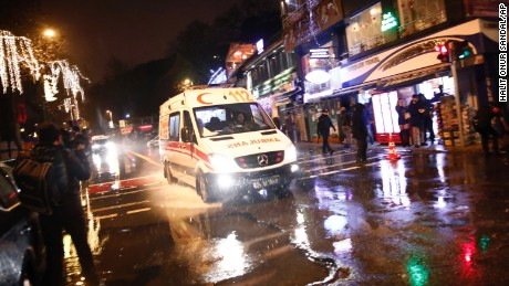 An ambulance rushes from the scene of an attack in Istanbul, early Sunday, Jan. 1, 2017. Turkey's state-run news agency said an armed assailant has opened fire at a nightclub in Istanbul during New Year's celebrations. (AP Photo/Halit Onur Sandal)