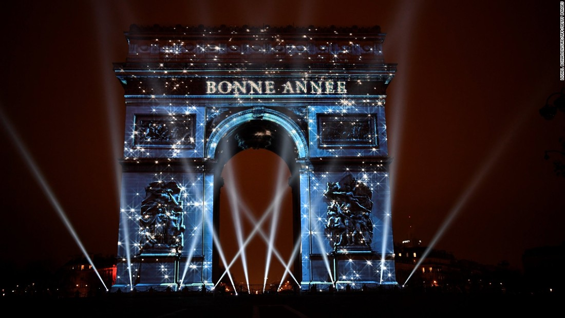 "The Arc de Triomphe in Paris, France, is illuminated by a laser and 3D mapping display reading ""Bonne Année"" (""Happy New Year"")."