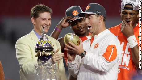 GLENDALE, AZ - DECEMBER 31:  Head coach Dabo Swinney of the Clemson Tigers holds the Fiesta Bowl trophy after the Clemson Tigers beat the Ohio State Buckeyes 31-0 to win the 2016 PlayStation Fiesta Bowl at University of Phoenix Stadium on December 31, 2016 in Glendale, Arizona.  (Photo by Jamie Squire/Getty Images)