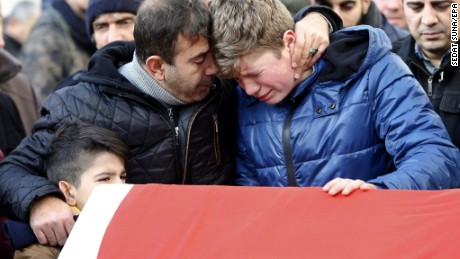 Relatives and friends mourn at the coffin during the funeral of Ayhan Arik, one of the 39 victims of the gun attack at the Reina nightclub on the Bosphorus river, in Istanbul, Turkey, January 01.