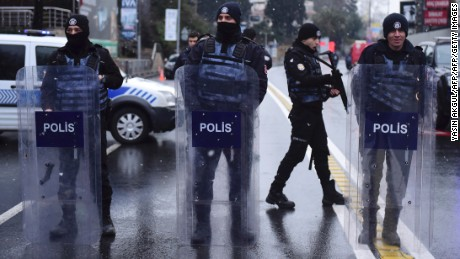 Turkish police officers stand guard close to the site of an armed attack near the Reina night club, one of the Istanbul's most exclusive party spots, early on January 1, 2017 after at least one gunmen went on a shooting rampage during New Year's Eve celebrations. Thirty-nine people, including many foreigners, were killed when a gunman reportedly dressed as Santa Claus stormed an Istanbul nightclub as revellers were celebrating the New Year, the latest carnage to rock Turkey after a bloody 2016. / AFP / YASIN AKGUL        (Photo credit should read YASIN AKGUL/AFP/Getty Images)