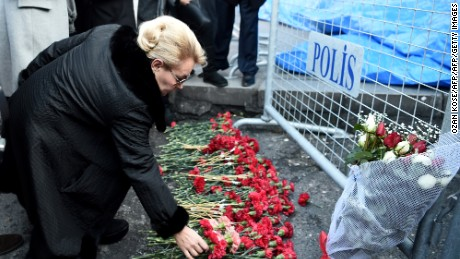 People lay flowers in front of the Reina night club, on January 2, 2017 in Istanbul, one day after a gunman killed 39 people, including many foreigners, in a rampage at an upmarket nightclub in Istanbul where revellers were celebrating the New Year. The shooting spree at the waterside Reina nightclub was unleashed when 2017 in Turkey was just 75 minutes old, after a year of unprecedented bloodshed that saw hundreds of people die in strikes blamed on jihadists and Kurdish militants and a bloody failed coup. / AFP / OZAN KOSE        (Photo credit should read OZAN KOSE/AFP/Getty Images)