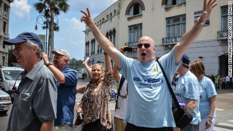 Passengers of the first US-to-Cuba cruise ship to arrive in the island nation in decades, walk in the streets of Havana right after disembarking on May 2, 2016.  The first US cruise ship bound for Cuba in half a century, the Adonia -- a vessel from the Carnival cruise's Fathom line -- set sail from Florida on Sunday, marking a new milestone in the rapprochement between Washington and Havana. The ship -- with 700 passengers aboard -- departed from Miami, the heart of the Cuban diaspora in the United States. / AFP / JORGE BELTRAN        (Photo credit should read JORGE BELTRAN/AFP/Getty Images)