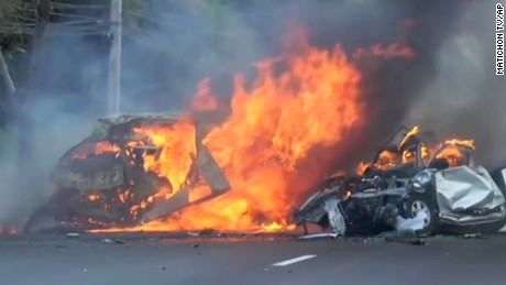 Two vehicles burn after they collided on a highway east of Bangkok, Thailand, on January 2, 2017.