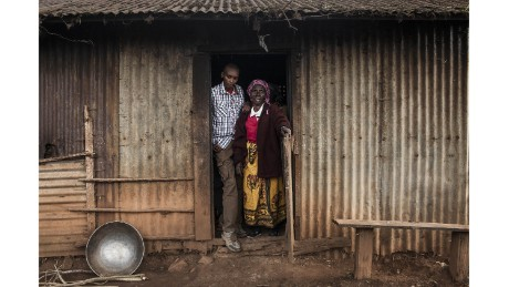 Muiruri with his grandmother Ruth, after whom he was originally named, outside the kitchen of his family home.