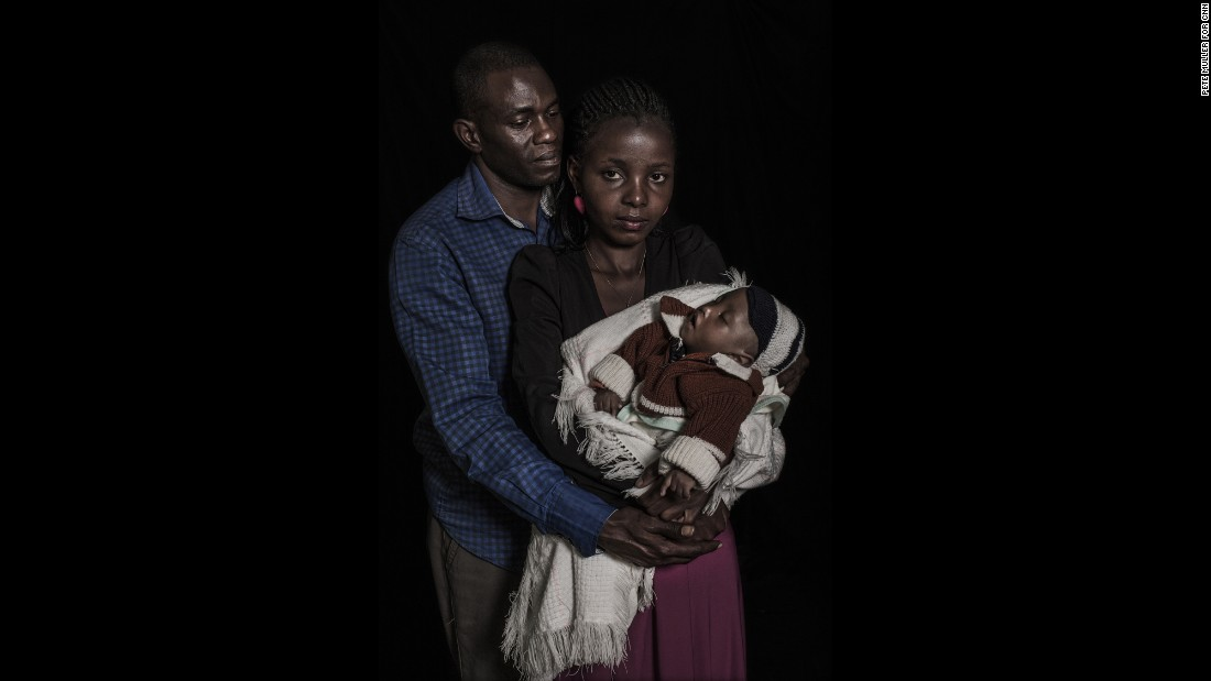 Maryann, 24, and Anthony Mwaura, 42, hold their one-year-old child who has an intersex condition as well as spinal problems. The couple says they are working to raise around US$300 to pay for a chromosomal test which they hope will determine his condition and identify a likely sex in which to raise their child.