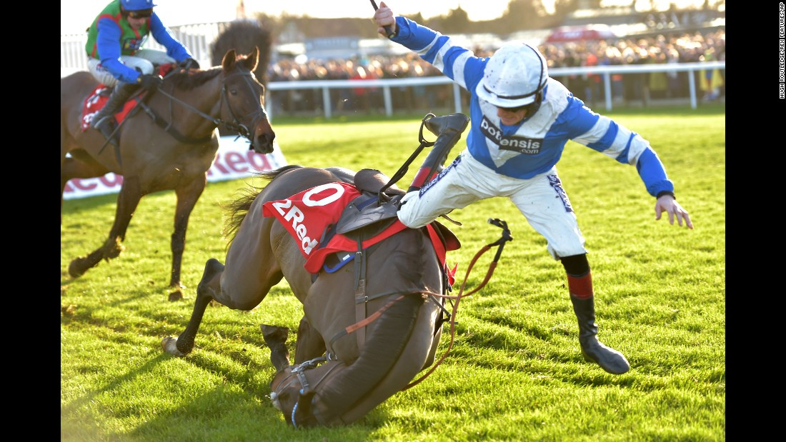 Sam Twiston-Davies falls off his horse Frodon as they compete in a steeplechase in Kempton, England, on Monday, December 26.