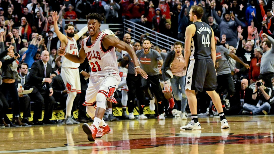 Chicago's Jimmy Butler (No. 21) reacts after scoring the game-winning basket against Brooklyn on Wednesday, December 28. Butler had 40 points in the 101-99 victory.
