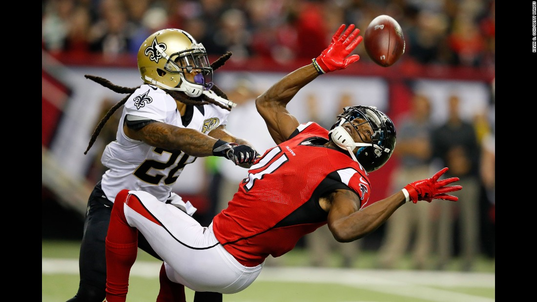 New Orleans cornerback B.W. Webb, left, breaks up a pass intended for Atlanta's Julio Jones during an NFL game in Atlanta on Sunday, January 1. Atlanta won 38-32 to clinch a first-round bye in the playoffs.