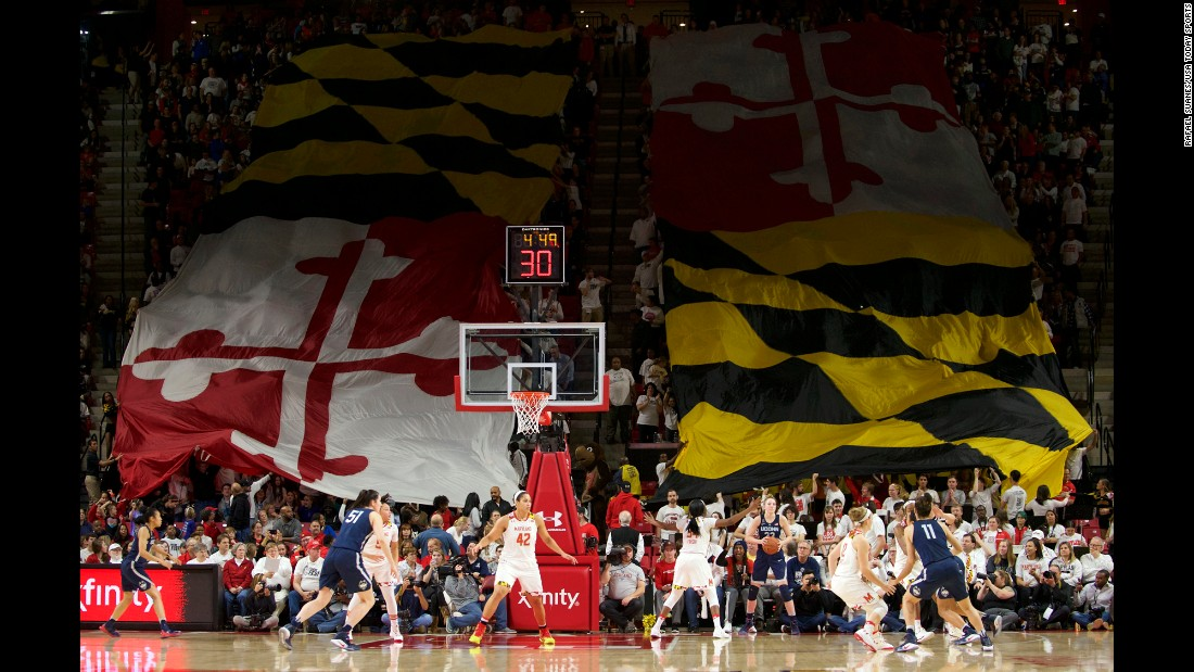 A giant Maryland flag is waved by fans during a college basketball game at the University of Maryland on Thursday, December 29.