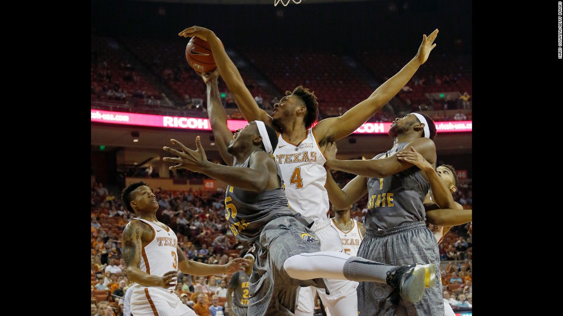 Texas' James Banks blocks a shot by Kent State's Jimmy Hall during a college basketball game in Austin, Texas, on Tuesday, December 27.