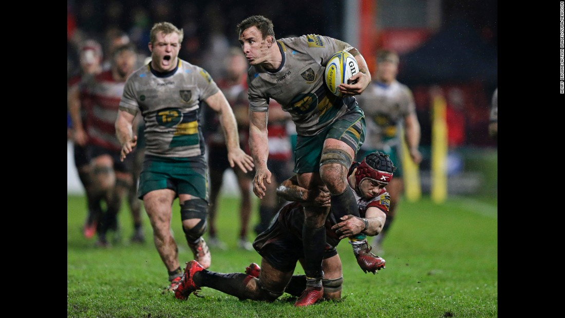 Gloucester Rugby's Lewis Ludlow tries to tackle Northampton's Louis Picamoles during a Premiership match in Gloucester, England, on Sunday, January 1.