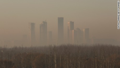 BEIJING, CHINA - DECEMBER 31:  Buildings at central business district are shrouded in heavy smog on December 31, 2016 in Beijing, China. Beijing Meteorological Bureau has issued an orange alert for heavy smog from December 30 to January 1.  (Photo by Lintao Zhang/Getty Images)