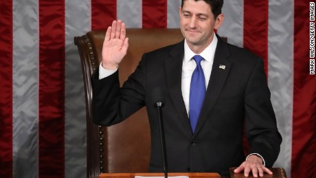 House Speaker Paul Ryan (R-WI), has his hand on a bible as he is sworn in as House Speaker, during a session in the House Chamber, January 3, 2017 in Washington, DC.