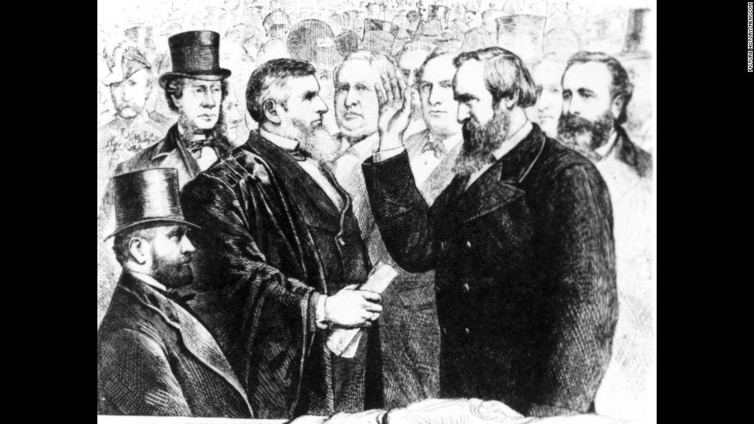 Chief Justice Morrison R. Waite administers the oath of office to Rutherford B. Hayes. The usual inauguration day back then, March 4, fell on a Sunday in 1877. So the public ceremony was held on a Monday.