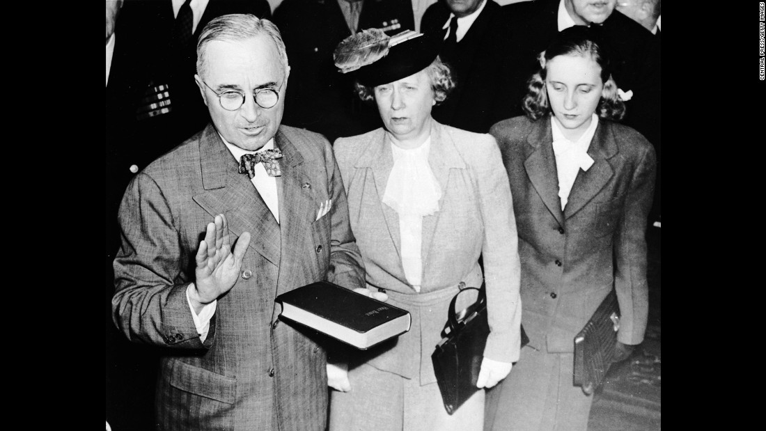 Harry S. Truman holds the Bible as he takes the oath of office in 1945. Standing beside him are his wife, Bess, and his daughter, Margaret. Truman was the vice president under Franklin D. Roosevelt, who died in office. Truman won re-election in 1948.