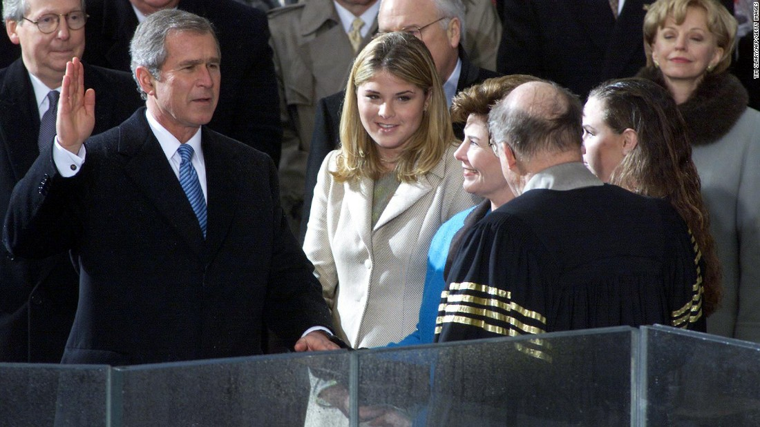 George W. Bush takes the oath of office from Supreme Court Chief Justice William Rehnquist in 2001. Standing with Bush, from left, are daughter Jenna, wife Laura and daughter Barbara. Bush, the eldest son of former President George H.W. Bush, served two terms.