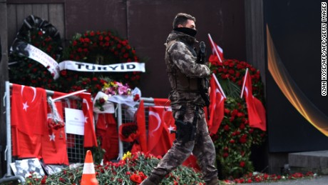 A Turkish special force police officer patrols in front of the Reina nightclub on January 4, 2017 in Istanbul, three days after a gunman killed 39 people on New Year's night.   The gunman had fought in Syria for Islamic State jihadists, a report said on January 3, as Turkish authorities intensified their hunt for the attacker. Of the 39 dead, 27 were foreigners, mainly from Arab countries, with coffins repatriated overnight to countries including Lebanon and Saudi Arabia. / AFP / OZAN KOSE        (Photo credit should read OZAN KOSE/AFP/Getty Images)