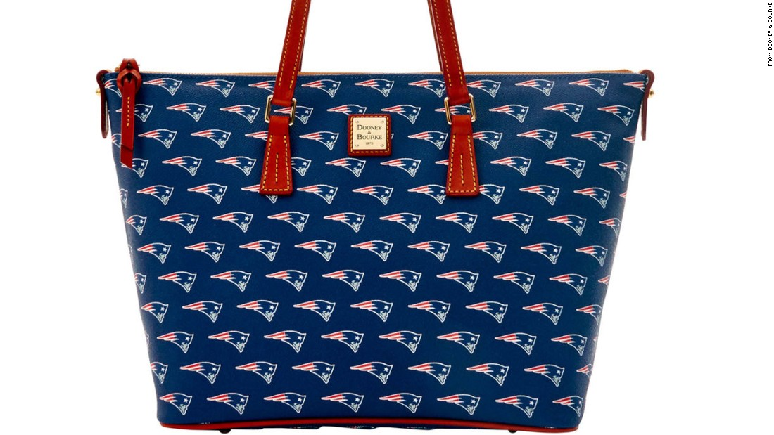 "For the fashion-forward tailgater, <a href=""http://www.dooney.com/nfl/"" target=""_blank"">Dooney & Bourke's line of NFL handbags</a> are stylish and functional."