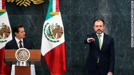 "Mexican President Enrique Pena Nieto (L) swears the new Foreign Minister, Luis Videgaray (C) in and the new Culture Minister Maria Cristina Garcia, during a ceremony at Los Pinos presidential residence in Mexico City on January 04, 2017. President Enrique Pena Nieto announced that Videgaray was replacing Claudia Ruiz Massieu, with the instruction to ""accelerate dialogue"" with the US president-elect's team in order to establish ""constructive relations."" / AFP / ALFREDO ESTRELLA        (Photo credit should read ALFREDO ESTRELLA/AFP/Getty Images)"