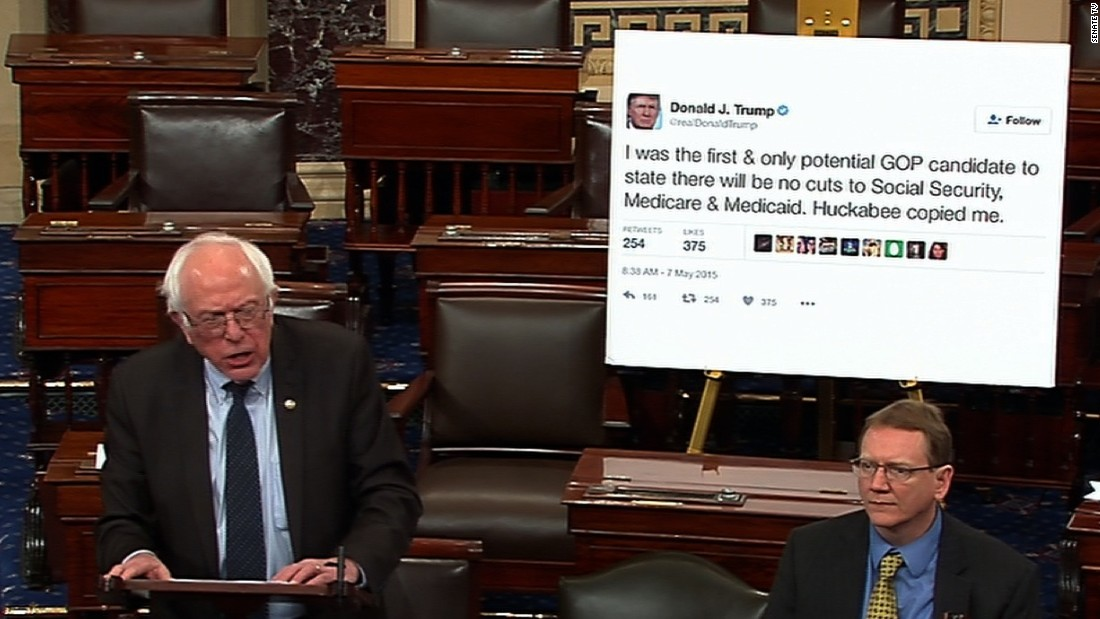 "Sanders <a href=""http://www.cnn.com/videos/politics/2017/01/05/bernie-sanders-trump-tweet-poster-senate-sot.cnn"" target=""_blank"">brings a giant printout of one of Donald Trump's tweets</a>, in which the President-elect promised not to cut Social Security, Medicare and Medicaid, to a debate at the Senate in Washington on January 4."