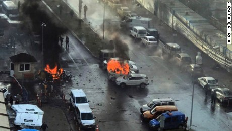 Cars burn after a car bomb explosion in Izmir, Turkey, Thursday, Jan. 5, 2017. An explosion believed to have been caused by a car bomb in front of a courthouse in the western Turkish city of Izmir on Thursday wounded several people, a local official said. Two of the suspected attackers were killed in an ensuing shootout with police. (DHA-Depo Photos via AP)