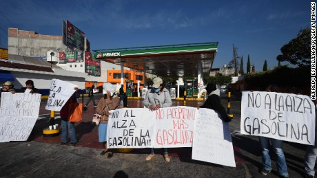 Demonstrators protest against the rise in fuel prices at a petrol station in Mexico City on Thursday.