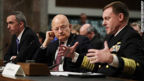 "U.S. Cyber Command Commander, National Security Agency Director, Central Security Services Chief Adm. Michael Rogers, right, accompanied by Director of National Intelligence James Clapper, center, and Defense Undersecretary for Intelligence Marcel Lettre II, testifies on Capitol Hill on January 5, 2017, before the Senate Armed Services Committee hearing: ""Foreign Cyber Threats to the United States."""