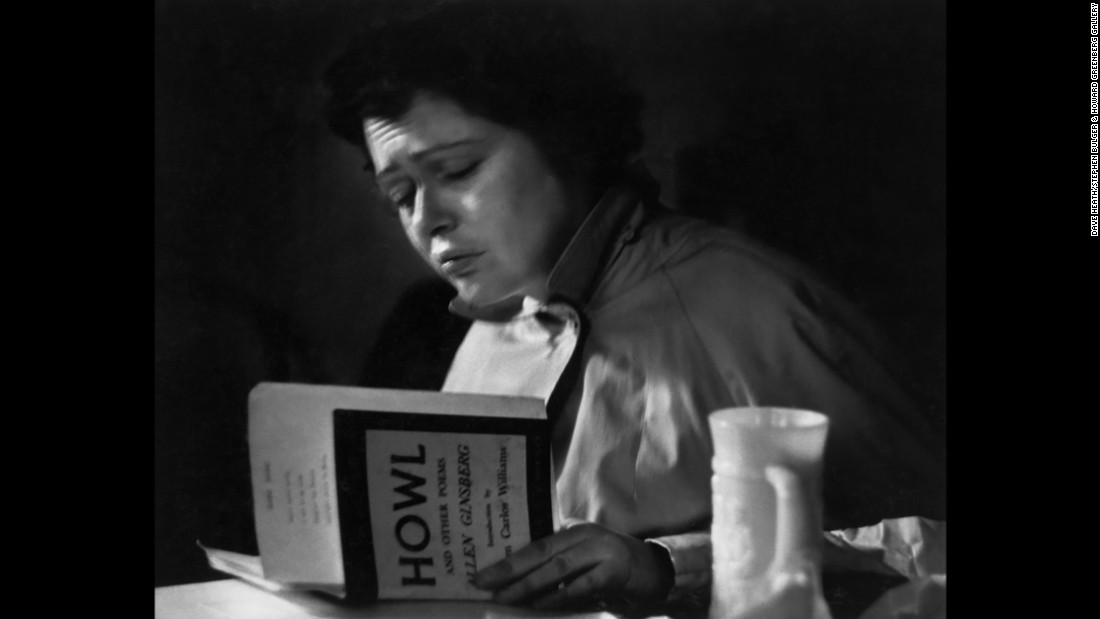 "A woman reads Allen Ginsberg's ""Howl and Other Poems"" inside the 7 Arts Coffee Gallery in New York City. The coffee shop, along with Washington Square Park, was a popular meeting spot for members of the Beat Generation, including Ginsberg himself. Photographer Dave Heath was there in the 1950s and took portraits of the people he came across."