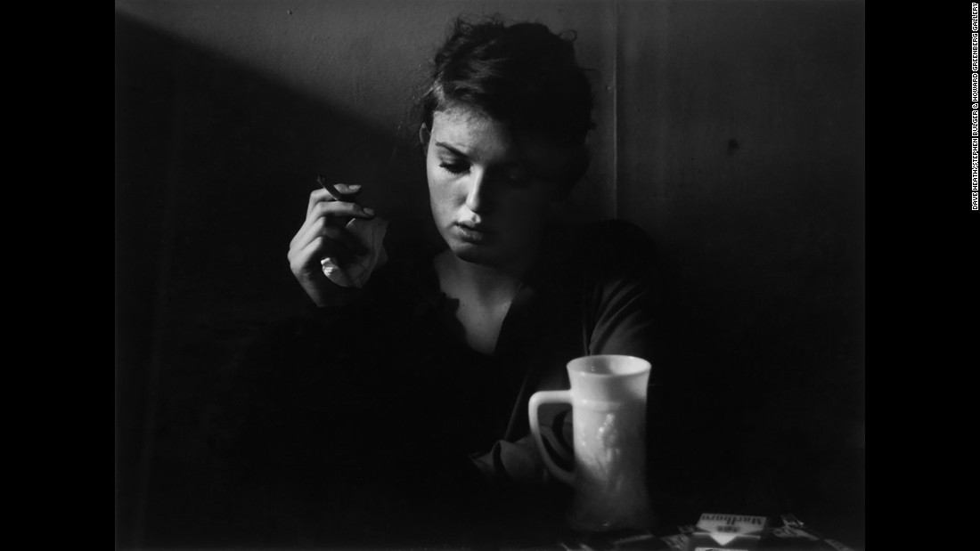 Poet Janine Pommy Vega sits inside the 7 Arts Coffee Gallery in 1957.