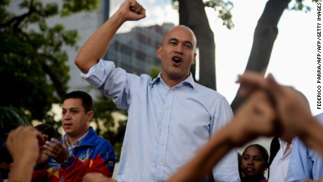 Venezuelan deputy Hector Rodriguez, chief of the pro-government legislative bloc, raises his clenched fist during a popular assembly at Bolivar Square, near the National Assembly in Caracas, on December 13, 2016. / AFP / FEDERICO PARRA        (Photo credit should read FEDERICO PARRA/AFP/Getty Images)
