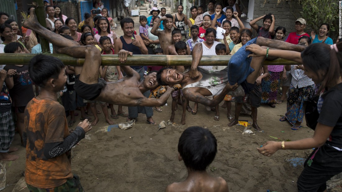 Young men in Yangon, Myanmar, engage in a traditional pillow fight game during Independence Day festivities on Wednesday, January 4.
