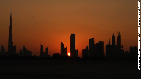 DUBAI, UNITED ARAB EMIRATES - NOVEMBER 16:  The sun sets behind the city skyline of Dubai on November 16, 2013 in Dubai, United Arab Emirates. Dubai is recovering from its slump during the global financial meltdown. The government has recently released figures that show that construction and tourism and the non-oil economy are once again growing.  (Photo by Christopher Furlong/Getty Images)