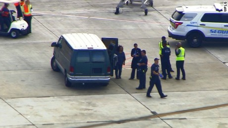 Police on the tarmac at the Ft Lauderdale airport, where a shooting took place on January 6.